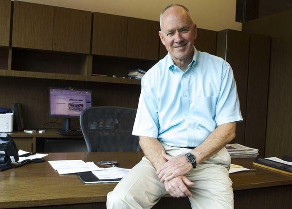 Mets General Manger Sandy Alderson poses for a