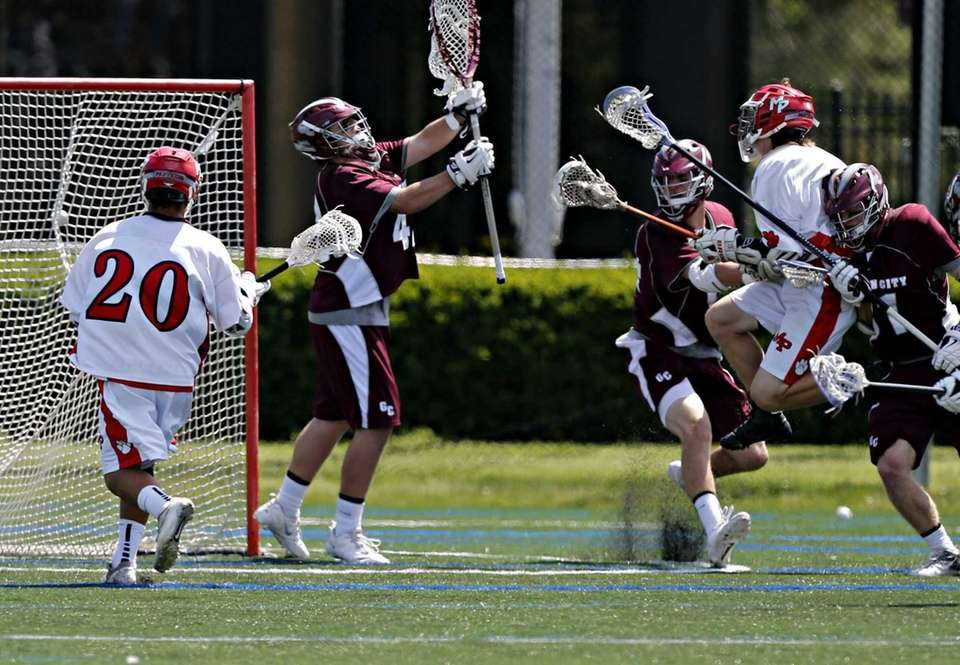 Miller Place's James Neilsen puts the ball into