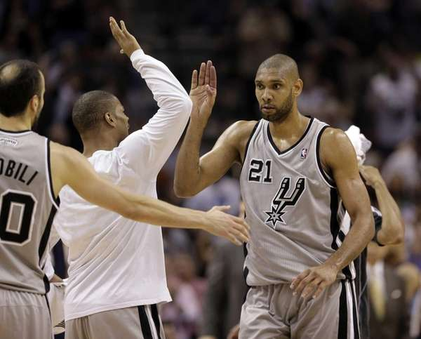 San Antonio Spurs' Tim Duncan celebrates with the