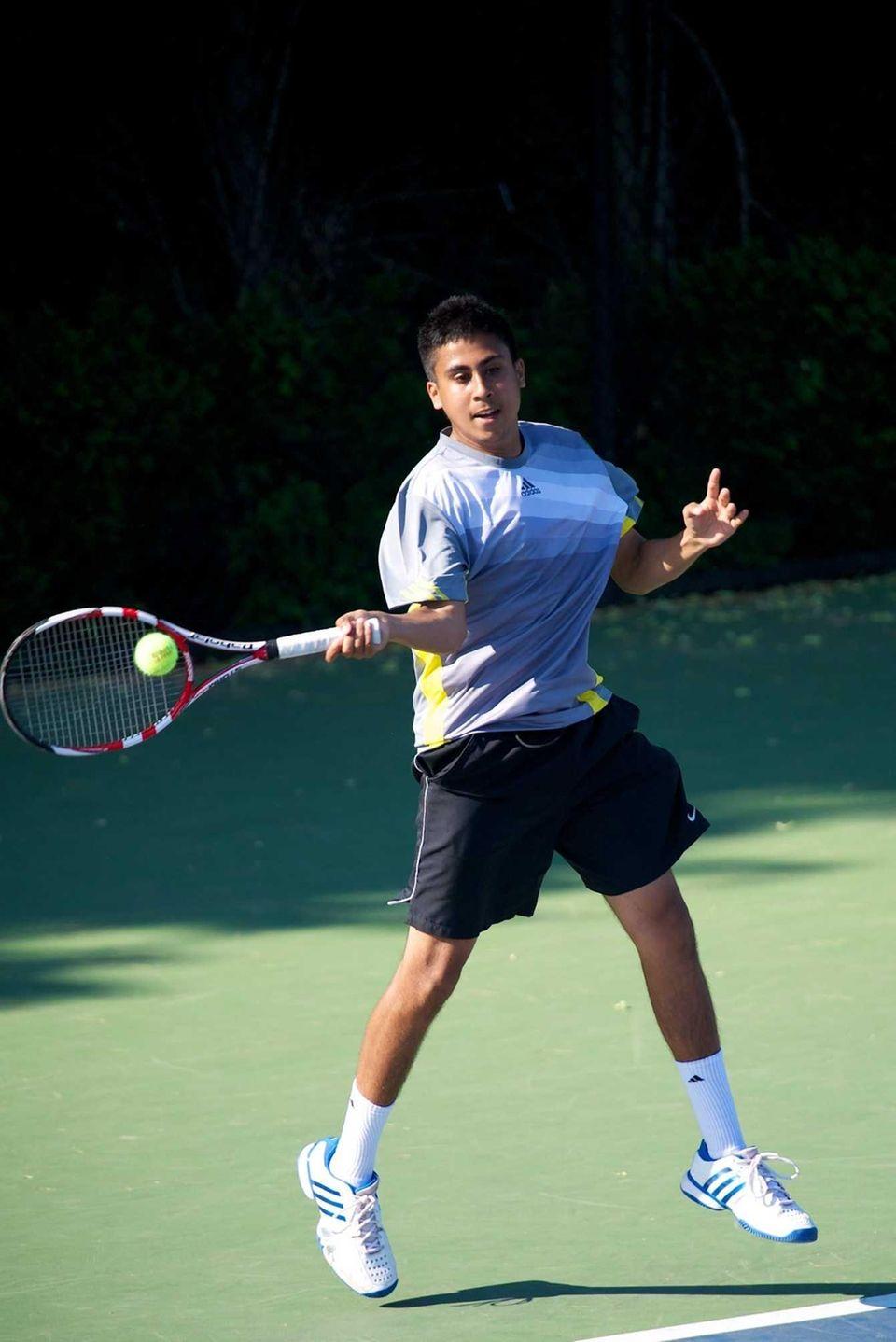 Zain Ali of Half Hollow Hills East hits