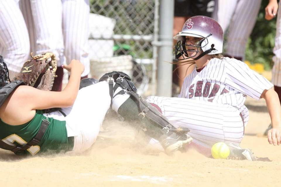 Bay Shore's Courtney Syrett, right, collides with Longwood's
