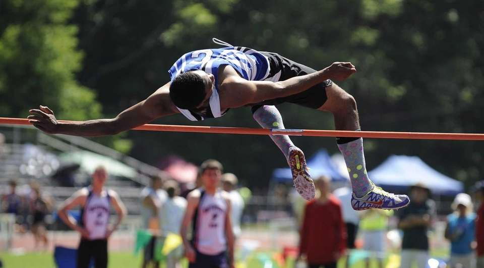 Copiague's Maurice Epps clears the bar in the