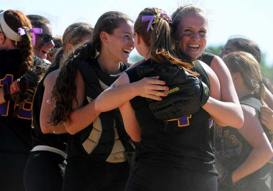 Sayville LF Cindy Griffin, right, hugs Catie Slevin