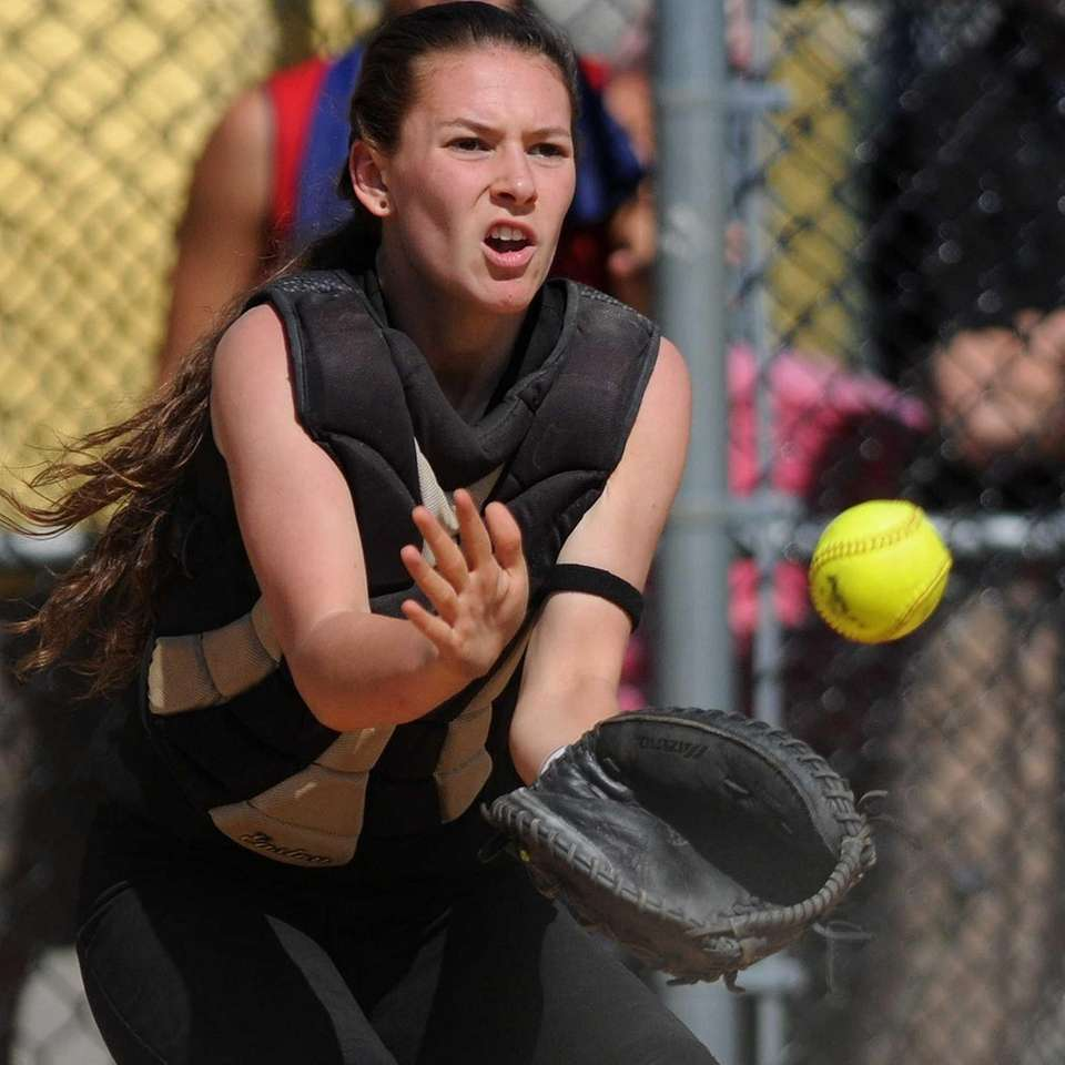 Sayville catcher Olivia Kaczmarak fields a throw from