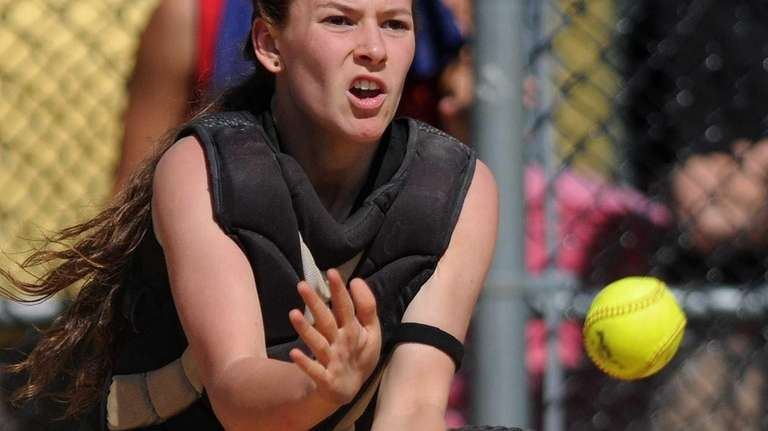 Sayville catcher Olivia Kaczmarak fields a throw from