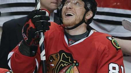 Chicago Blackhawks right wing Marian Hossa smiles after