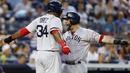 Mike Napoli of the Boston Red Sox celebrates