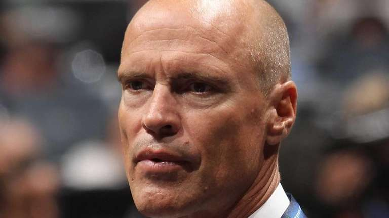 Mark Messier of the Rangers works on the