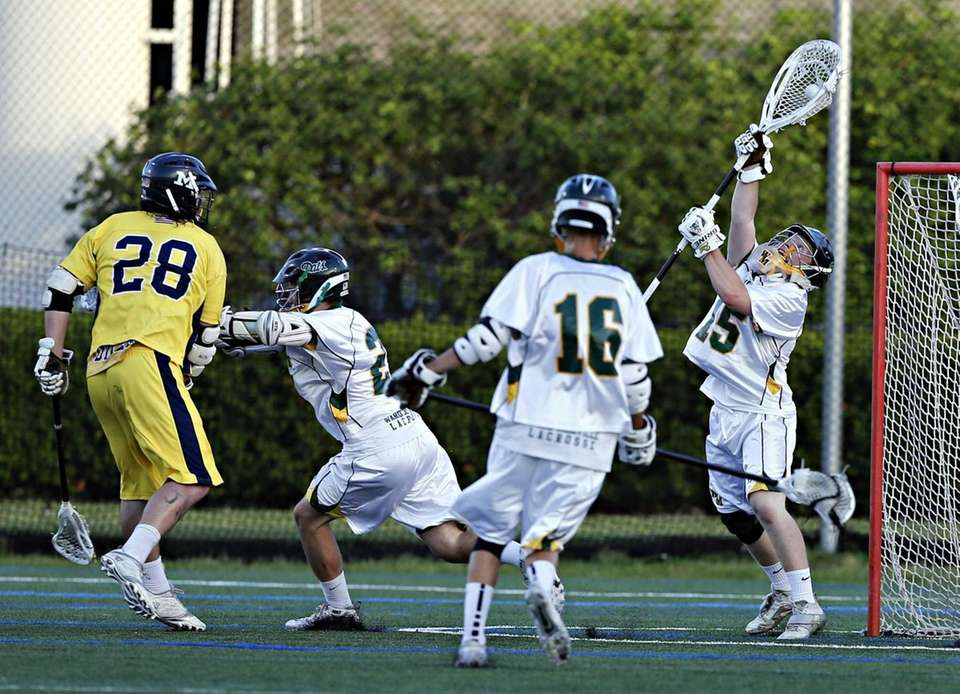 Ward Melville goalie Daniel Nemirov makes the save