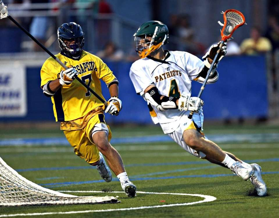 Ward Melville's Daniel Bucaro drives against Massapequa's Nick