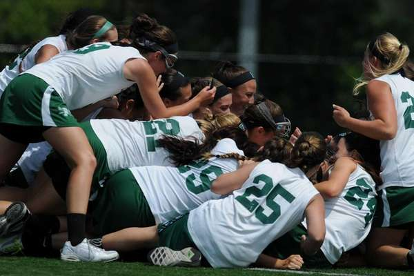 Farmingdale teammates celebrate after their 12-11 win over