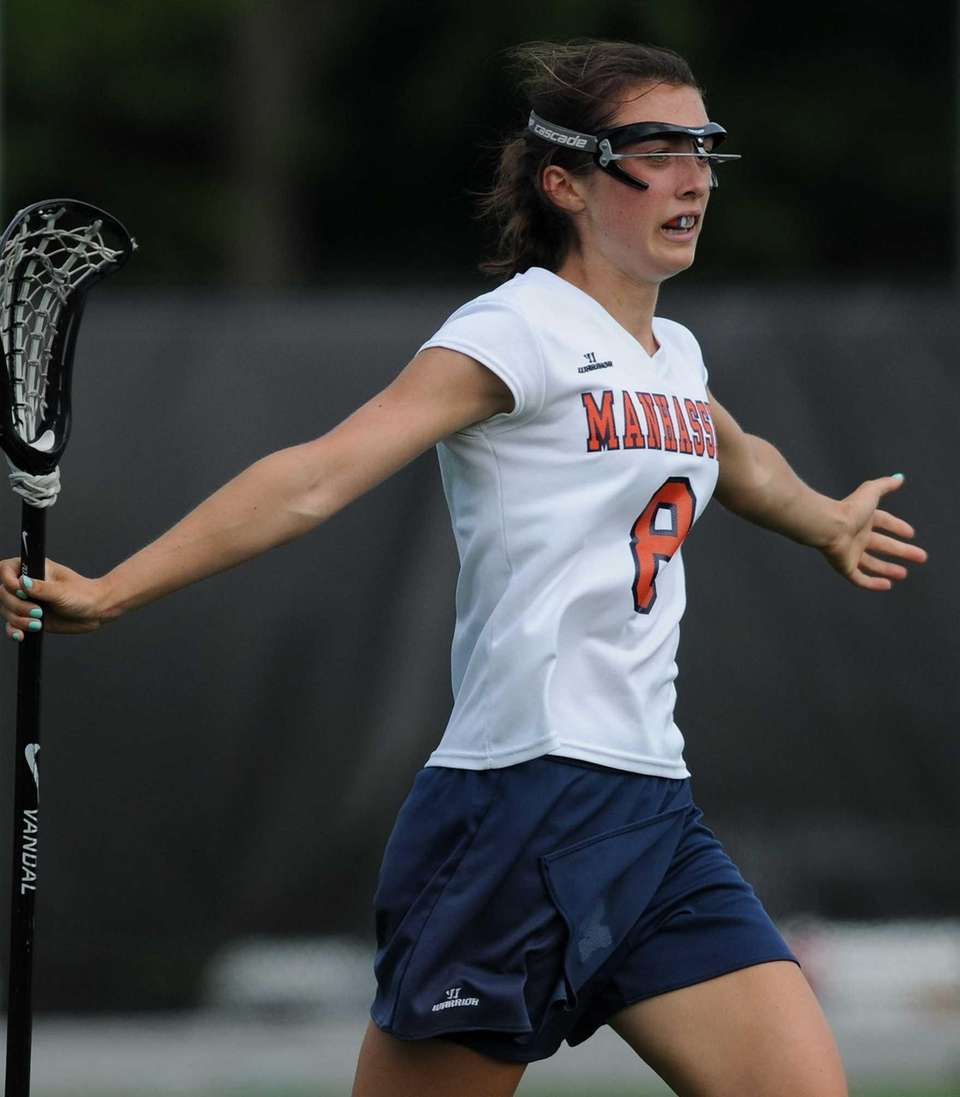 Manhasset's Julia Glynn reacts after scoring a goal