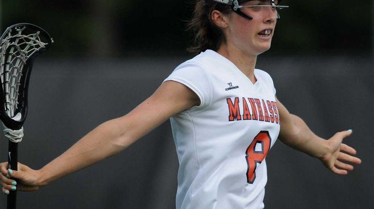 Manhasset's Julia Glynn reacts after scoring a goal