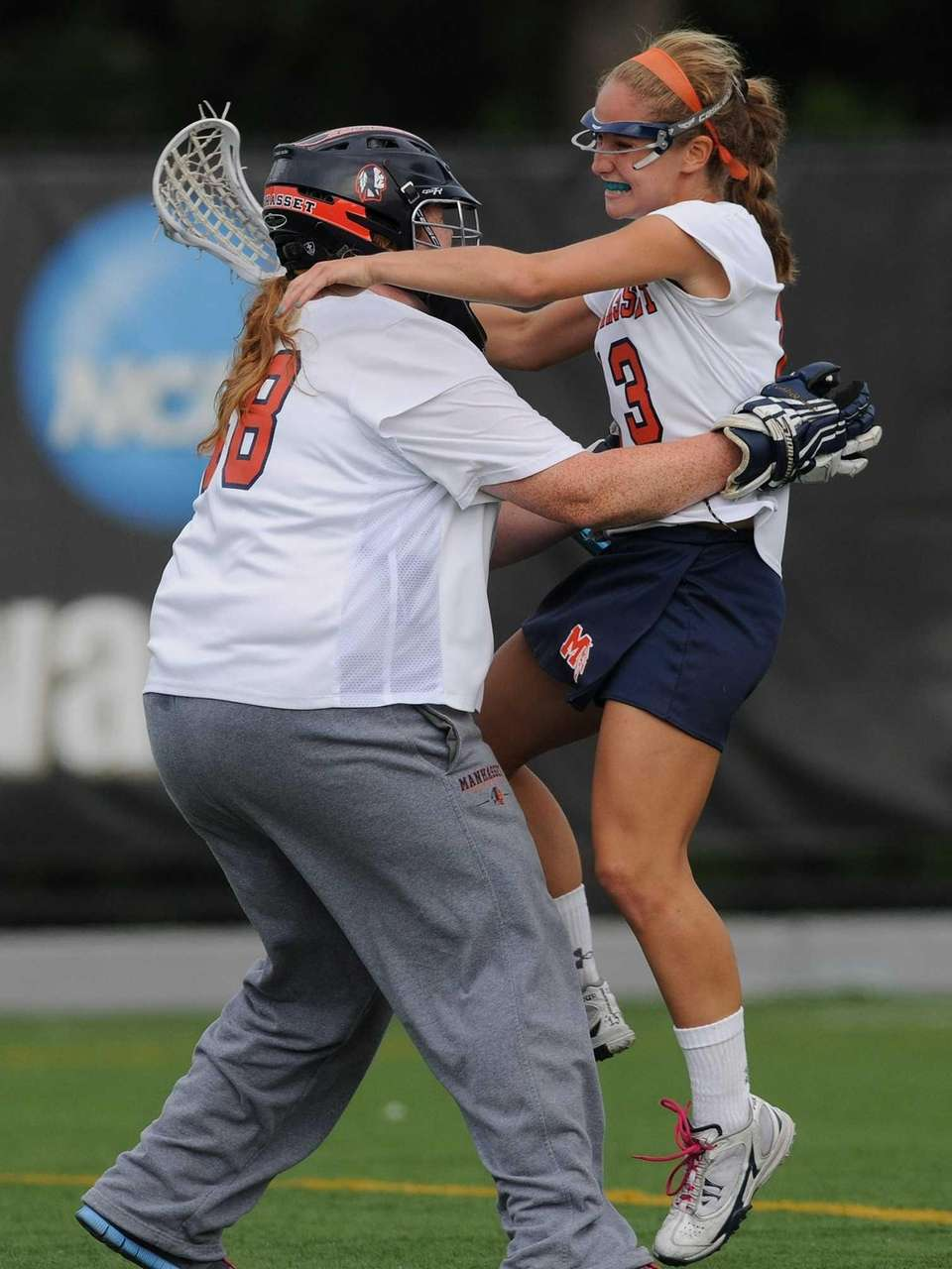 Manhasset goalie Erin Coleman, left, and Madison Molinari