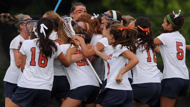 Manhasset teammates celebrate after their 11-7 win over