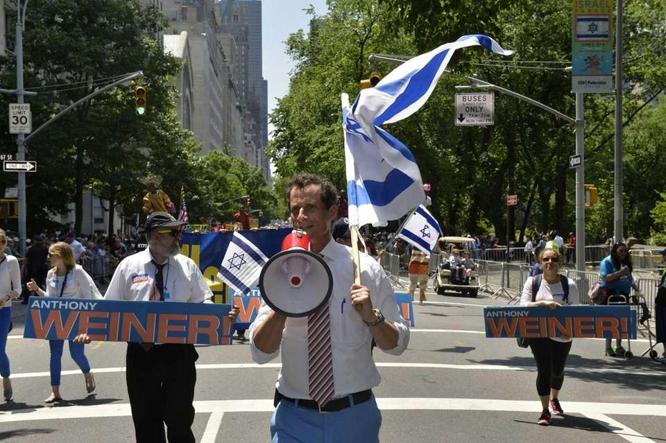 New York mayoral candidate Anthony Weiner walks along