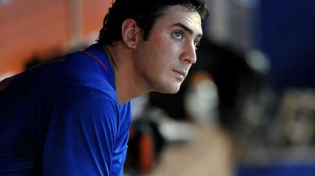 Matt Harvey sits in the dugout during the