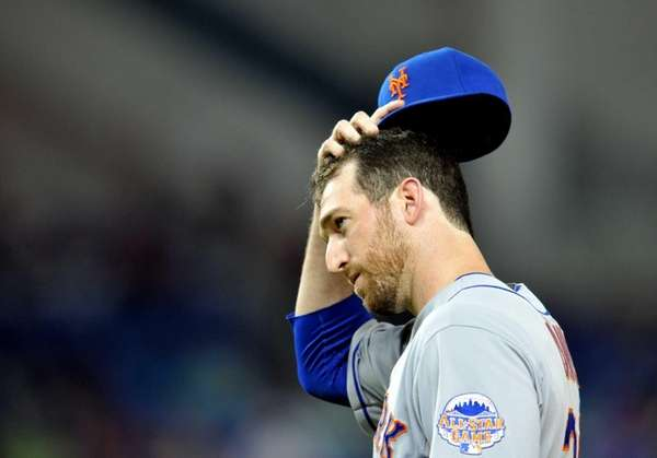Ike Davis looks on during a game against