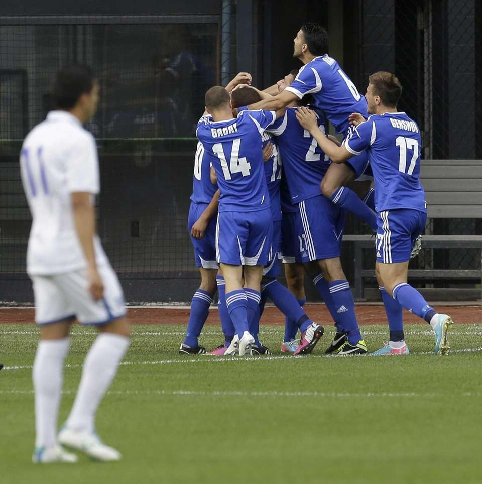 Israel celebrates a goal by Shimon Abuhatzira during