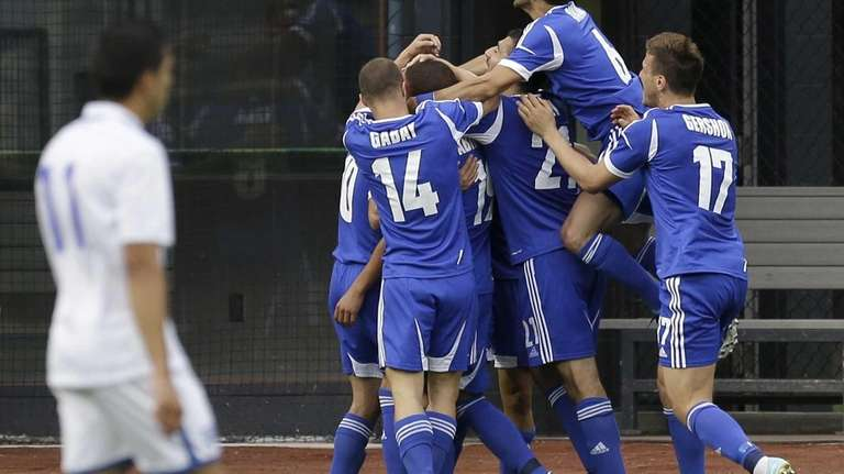 Israel celebrates a goal by Shimon Abuhatzira during