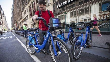 A man checks out a Citi Bike from