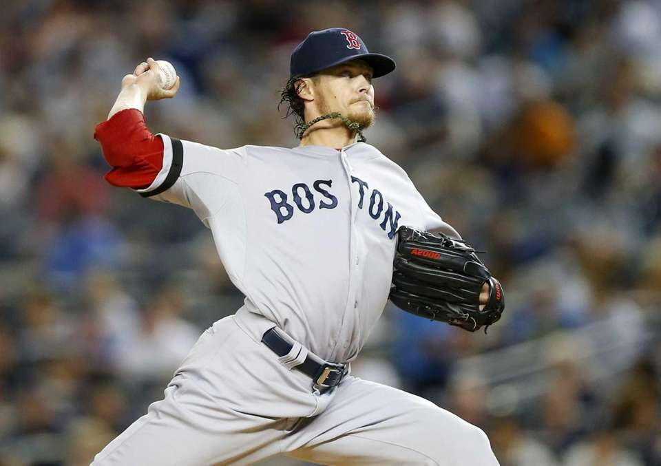 Clay Buchholz delivers a pitch during a game