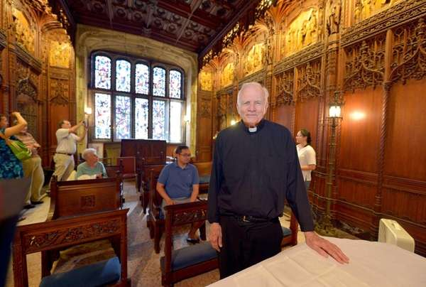 Father Damian stands inside Genevieve's Chapel at the
