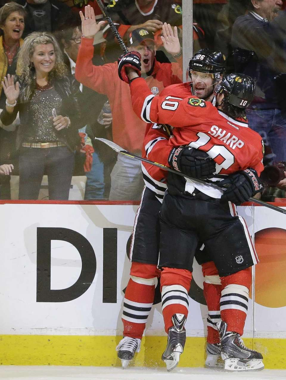Chicago Blackhawks center Patrick Sharp (10) celebrates with
