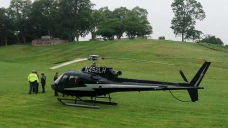 Officials on the scene where a helicopter made