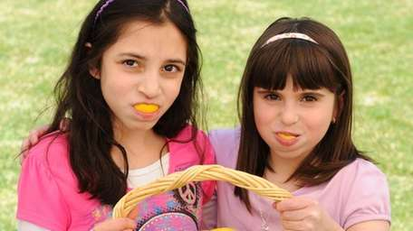 Young girls pucker up with lemon slices as