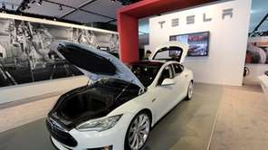 Tesla's Model S car sits in a showroom.