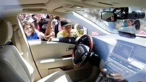 Children look inside the self-driving car at Google