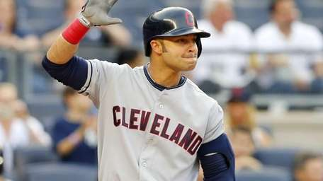 Cleveland Indians' Nick Swisher waves to the crowd