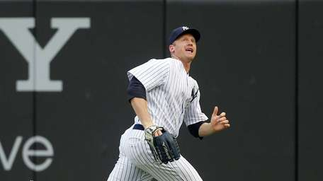 Yankees' Lyle Overbay runs down a foul ball