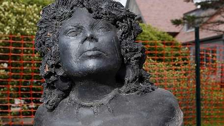 The mysterious sculpture of a woman was left