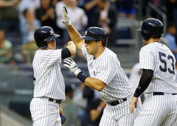 Mark Teixeira celebrates with Brett Gardner and Austin