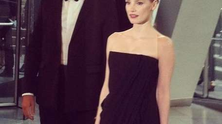 Designer Riccardo Tisci, left, and actress Jessica Chastain