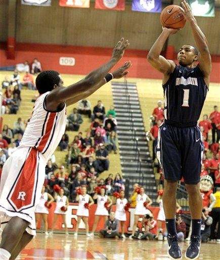 Monmouth's Dion Nesmith (1) shoots against Rutgers' Eli