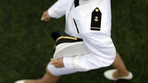 A graduating U.S. Naval Academy Midshipman marches into