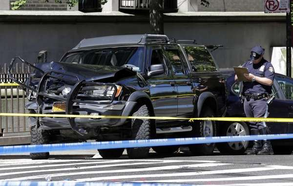 New York City Police investigate an automobile that