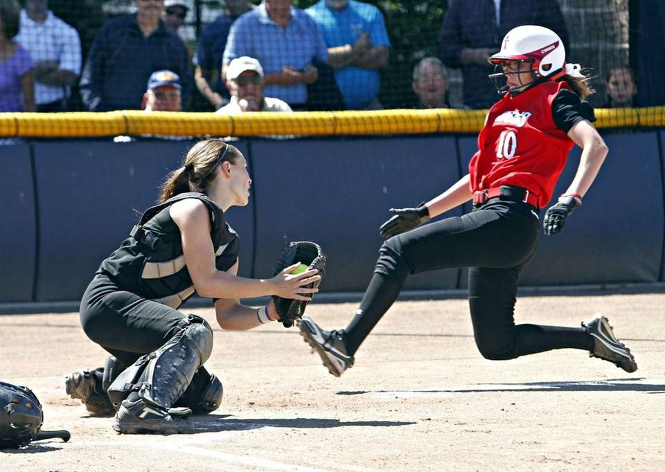 Sayville catcher Olivia Kaczmarek puts the tag on