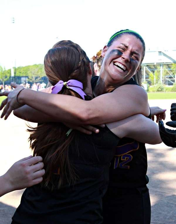 Sayville's Caitlin Slevin and Emily Sellitti embrace after