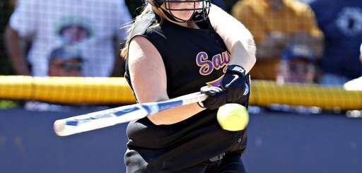 Sayville pitcher Julia Simpson hits an RBI single