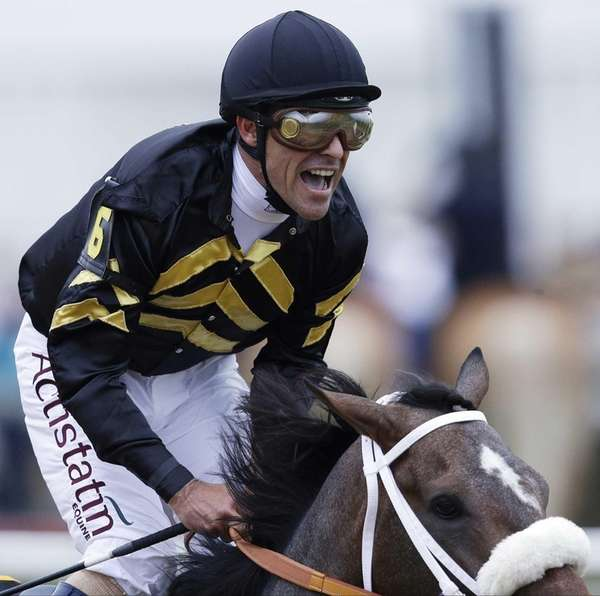 Jockey Gary Stevens celebrates aboard Oxbow after winning