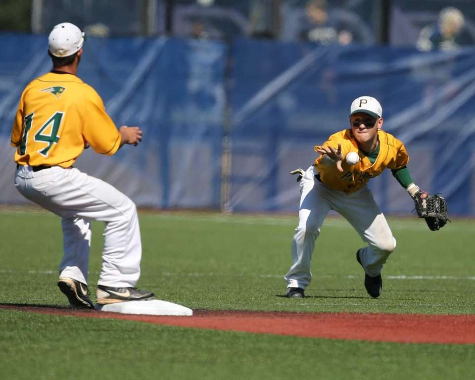Ward Melville's Nicholas Vitale gets the throw from