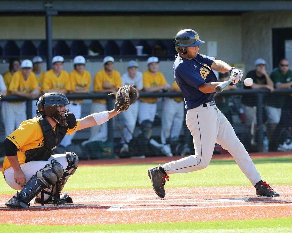 Massapequa's Matt Pagano gets a base hit against