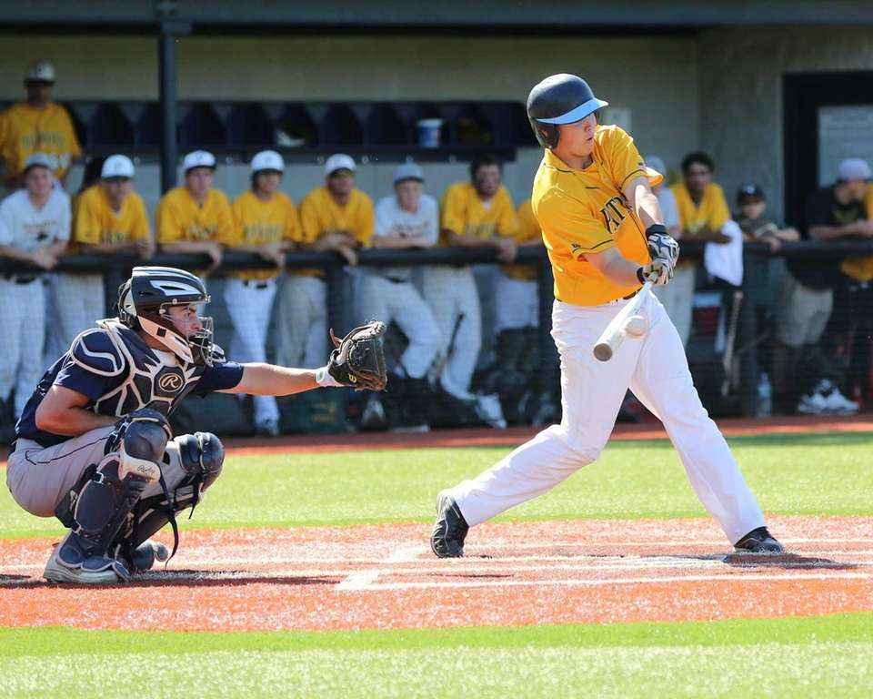 Ward Melville's Phil Carballeira gets a base hit