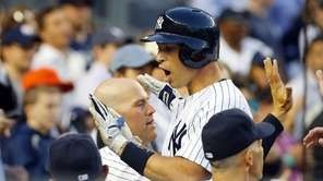 Mark Teixeira celebrates his home run during the