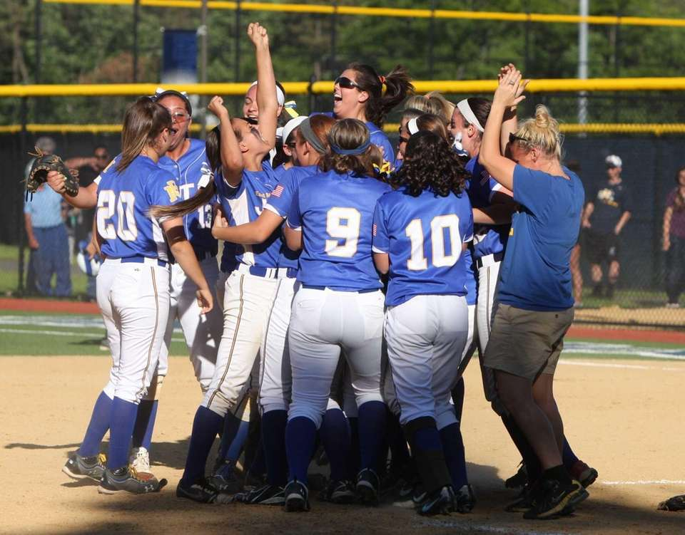 East Meadow celebrates the last out and the