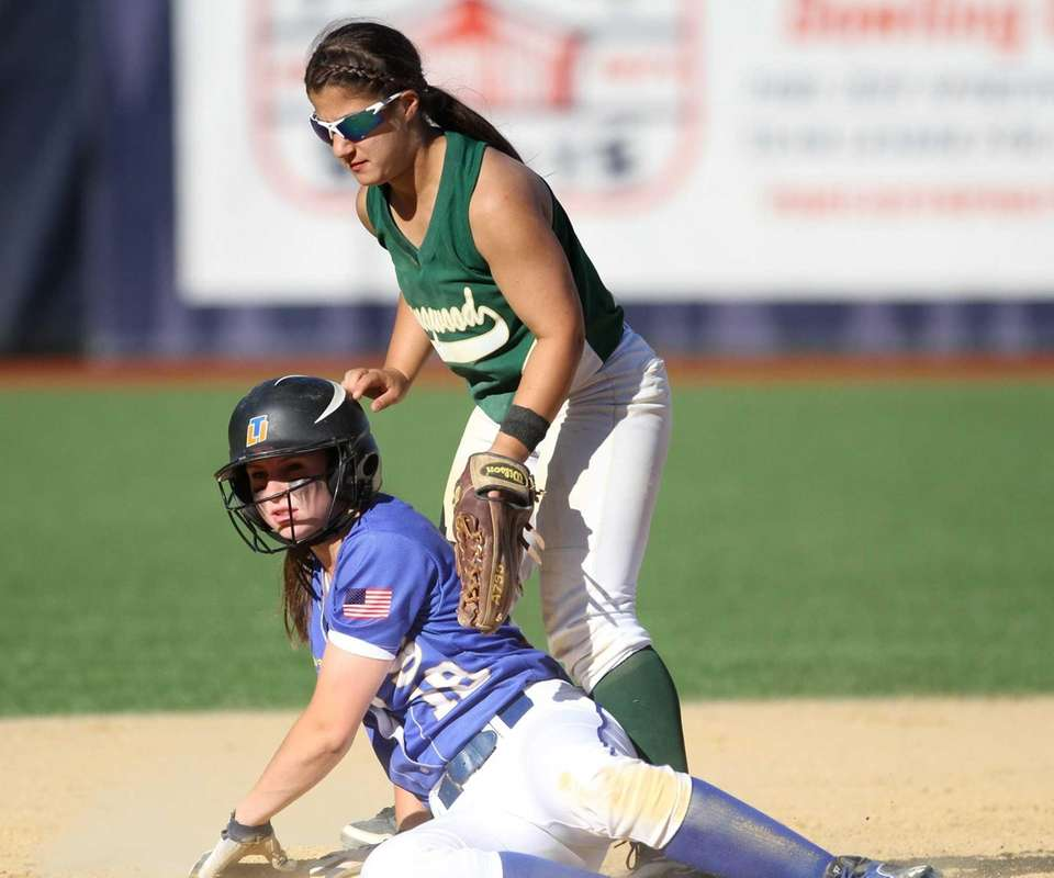 Claire Ravis of East Meadow beats the tag